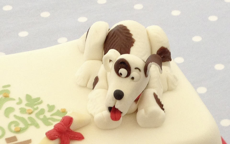 Put your dog on top of a cake!